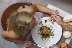 Man feeding woman at dinner table, overhead view Royalty Free Stock Image