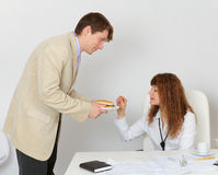Man feeding woman a sandwich Royalty Free Stock Image