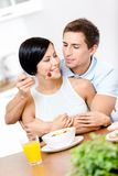 Man feeds and embraces his girlfriend Stock Photos