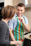 Man feeds his wife with vegetables Stock Image