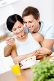 Man feeds and hugs his girlfriend Royalty Free Stock Images