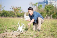 Man with crashed drone. Man feel bad with crashed drone in the park royalty free stock image