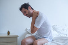 Man feeling back ache in the bed after sleeping Royalty Free Stock Images