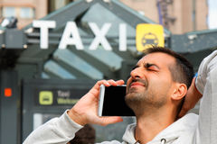 Man feeling bad becouse he having a problem to order taxi from his phone Stock Images