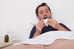 Man feeling bad lying in the bed Stock Photo