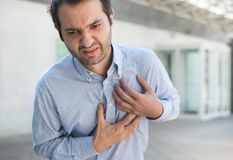 Man having  a sudden heart attack  and feeling bad Stock Image