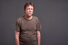 Man feeling bored. Expressions of a middle age man feeling bored royalty free stock image