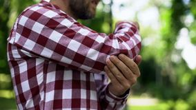 Man feeling elbow pain, sport injury, chronic rheumatism, health problem. Stock photo stock photos
