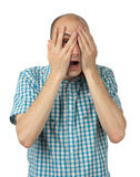 Man feeling fear. Young man feeling fear with open mouth and closing eyes with hands Royalty Free Stock Image
