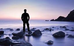 Man feeling freedom on beach during sunrise Royalty Free Stock Photo