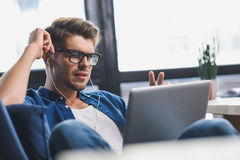 Man feeling frustrated while looking into laptop Stock Photos