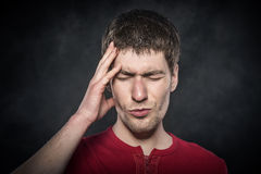 Man feeling a headache or intensely thinking. Stock Photo