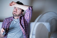 Man feeling hot because of summer heat stock image