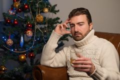 Man feeling lonely and drinking alcohol alone. Man feeling lonely and drinking alcohol Stock Photos