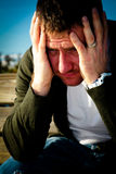 Man Feeling Pain. Man overwhelmed, experiencing pain and stress Royalty Free Stock Photography