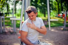 A man feeling pain in his chest during sport and workout in the stock photo