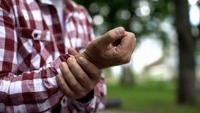 Man feeling wrist pain, carpal tunnel syndrome, osteoarthritis, inflammation. Stock photo stock photos