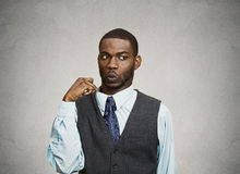 Man feels awkward, ashamed in a hot situation Royalty Free Stock Image