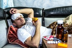 The man feels bad. And is lying under the blanket Royalty Free Stock Image