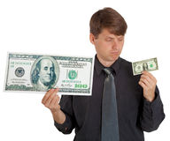Man feels difference between large and small money Stock Photo