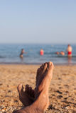 Man feet on beach Stock Images
