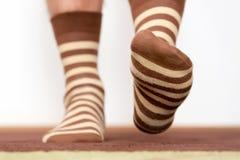 Man feet on brown socks Royalty Free Stock Image