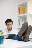 Man with feet on desk Royalty Free Stock Images