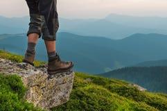 Man feet on rock Royalty Free Stock Photos