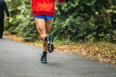 Man feet runner marathon running in autumn Park Royalty Free Stock Photography