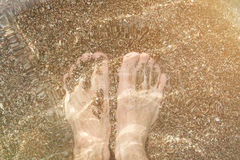 Man feet in sea water Royalty Free Stock Photography