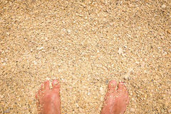 Man feet standing in sand Royalty Free Stock Images