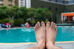 Man feet at swimming pool Royalty Free Stock Photo