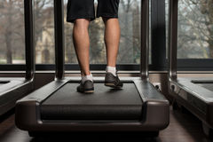 Man Feet On Treadmill Stock Photo
