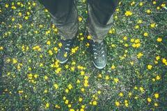 Man Feet trekking boots walking on grass Royalty Free Stock Photography