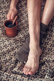 Man feet on woolen plaid and cup of coffee Royalty Free Stock Photo