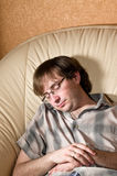 The man fell asleep in a chair Royalty Free Stock Photo