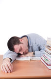 Man fell asleep on a tabel near a stack of books Stock Photography