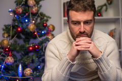 Man felling depressed and lonely during the christmas time Stock Photo