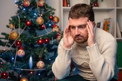 Man felling depressed and lonely during the christmas time Royalty Free Stock Image