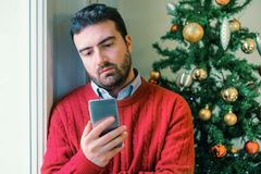Man felling negative emotions during christmas Stock Images