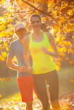 Man and female training outside during autumn day. Royalty Free Stock Images