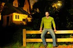 Man on fence stock photo