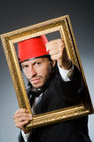 Man with fez  hat Stock Photography