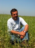 Man in a field Stock Images
