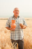 Man in field with bread royalty free stock photography