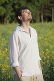 Man in field enjoying sunset Royalty Free Stock Image