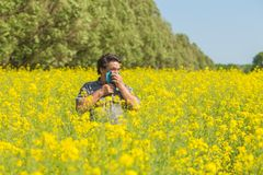 Man in the field suffers from allergies Stock Photo