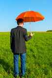 Man in the field with umbrella Royalty Free Stock Images