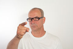 Man of fifty with glasses shows the fingers Royalty Free Stock Photography