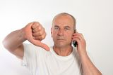 Man of fifty with a mobile phone Stock Photos